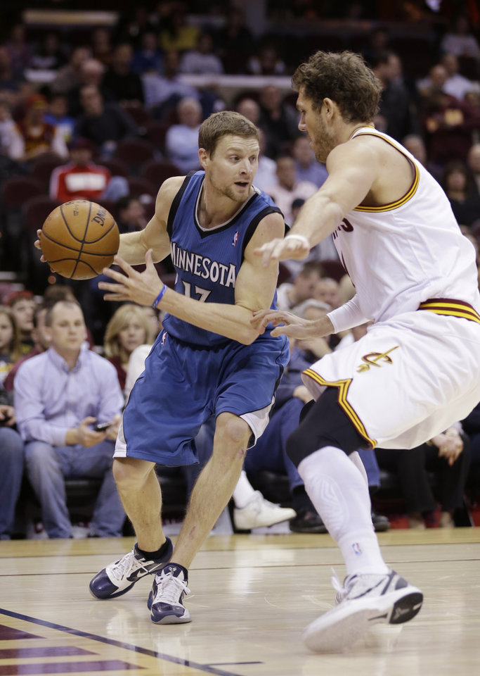 Minnesota Timberwolves' Luke Ridnour (13) drives past Cleveland Cavaliers' Luke Walton (4) during the second quarter of an NBA basketball game Monday, Feb. 11, 2013, in Cleveland. Ridnour scored a team-high 21 points for Minnesota's 100-92 win. (AP Photo/Tony Dejak)