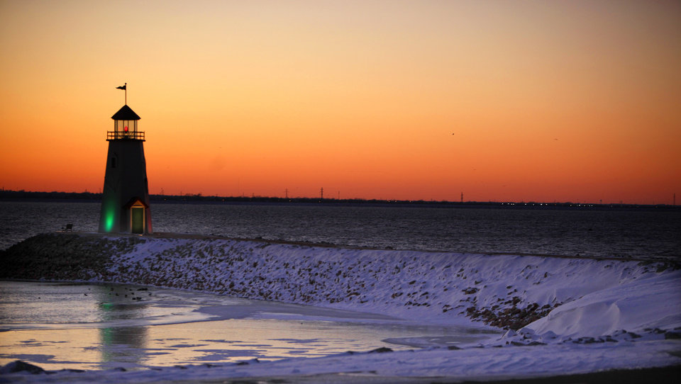 Photo - The sun sets at a frozen Lake Hefner, Wednesday, Feb. 9, 2011, in Oklahoma City. Photo by Sarah Phipps, The Oklahoman