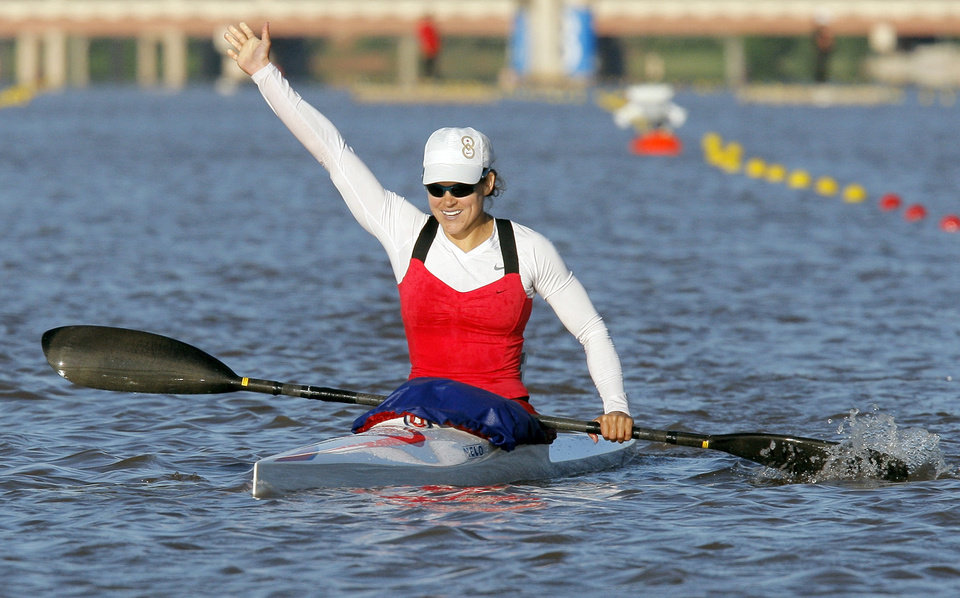 Photo - Carrie Johnson reacts after winning the women's kayak 500m final to qualify for the Olympic team, during the USA Canoe/Kayak U.S. Olympic Team Trials on the Oklahoma River in Oklahoma City, Friday, April 20, 2012. Photo by Nate Billings, The Oklahoman