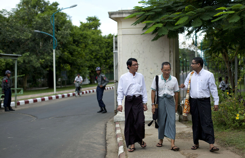Photo -   In this picture taken on Wednesday, Nov. 14, 2012, student leaders of a successive uprising, from left, Zaw Zaw Min, Hla Shwe, and Ragu Ne Myint walk outside the main gate of the University of Yangon, where President Barack Obama is scheduled to deliver a speech on Monday, Nov. 19, 2012, in Yangon, Myanmar. Since colonial times, the fight for change in Myanmar has begun on this leafy campus. It was a center of the struggle for independence against Britain and served as a launching point for pro-democracy protests in 1962, 1974, 1988 and 1996. For many, the school has today become a symbol of the country's ruined education system and a monument to a half century of misrule. (AP Photo/Gemunu Amarasinghe)