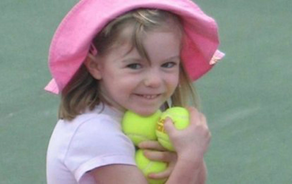 Photo - FILE - This undated  file photo made available by the London Metropolitan Police, shows missing British girl Madeleine McCann before she went missing from a Portuguese holiday complex. Police investigating the disappearance of Madeleine McCann cordoned off Monday, June 2, 2014 an area of scrubland near where the British girl vanished seven years ago. (AP Photo/London Metropolitan Police, File)