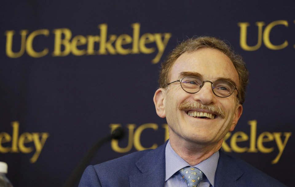 Photo - Randy Schekman, professor at the University of California, Berkeley, smiles while talking about winning the Nobel Prize in medicine during a news conference Monday, Oct. 7, 2013, in Berkeley, Calif. Two Americans and a German-American won the Nobel Prize in medicine Monday for discovering how key substances are transported within cells, a process involved in such important activities as brain cell communication and the release of insulin. James Rothman, 62, of Yale University, Randy Schekman, 64, of the University of California, Berkeley, and Dr. Thomas Sudhof, 57, of Stanford University shared the $1.2 million prize. (AP Photo/Eric Risberg)