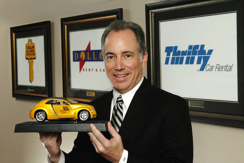 Photo - Scott Thompson, CEO of Dollar Thrifty Automotive Group, Inc, in the company's Tulsa headquarters office Tuesday,  Oct. 13, 2009. Photo by Jim Beckel, The Oklahoman ORG XMIT: KOD