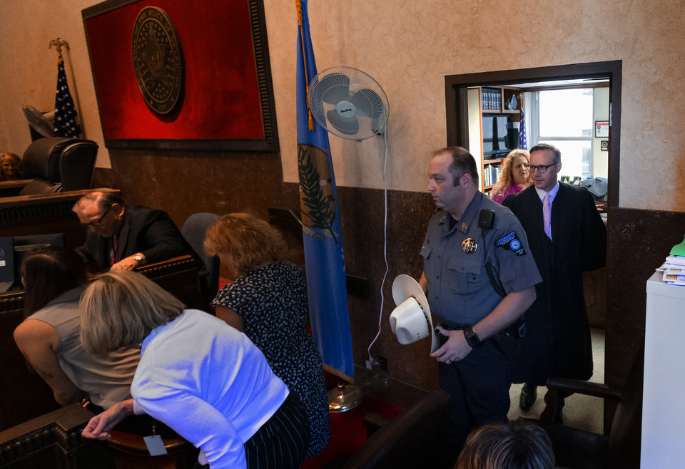 Photo - Judge Thad Balkman enters the courtroom before he delivers his decision in the opioid trial at the Cleveland County Courthouse in Norman, Okla. on Monday, Aug. 26, 2019. Judge Balkman ruled in favor of the State of Oklahoma, that Johnson and Johnson pay $572 million to a plan to abate the opioid crisis. The proceeding were the first public trial to emerge from roughly 2,000 U.S. lawsuits aimed at holding drug companies accountable for the nationÕs opioid crisis.  [Chris Landsberger/The Oklahoman]