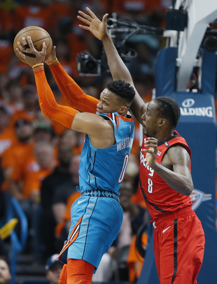 Photo - Oklahoma City's Russell Westbrook (0) grabs a rebound beside Portland's Al-Farouq Aminu (8) during Game 3 in the first round of the NBA playoffs between the Portland Trail Blazers and the Oklahoma City Thunder at Chesapeake Energy Arena in Oklahoma City, Friday, April 19, 2019. Photo by Bryan Terry, The Oklahoman