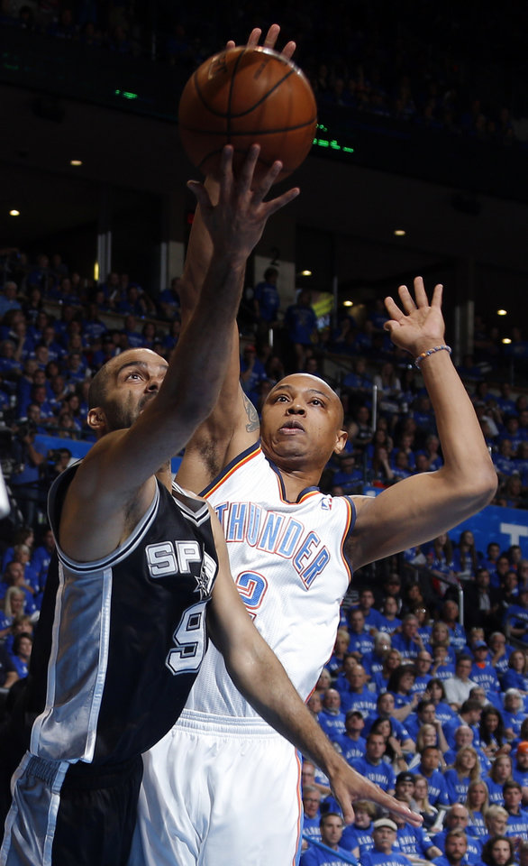 Photo - San Antonio's Tony Parker (9) shoots as Oklahoma City's Caron Butler (2) defends during Game 3 of the Western Conference Finals in the NBA playoffs between the Oklahoma City Thunder and the San Antonio Spurs at Chesapeake Energy Arena in Oklahoma City, Sunday, May 25, 2014. Photo by Bryan Terry, The Oklahoman