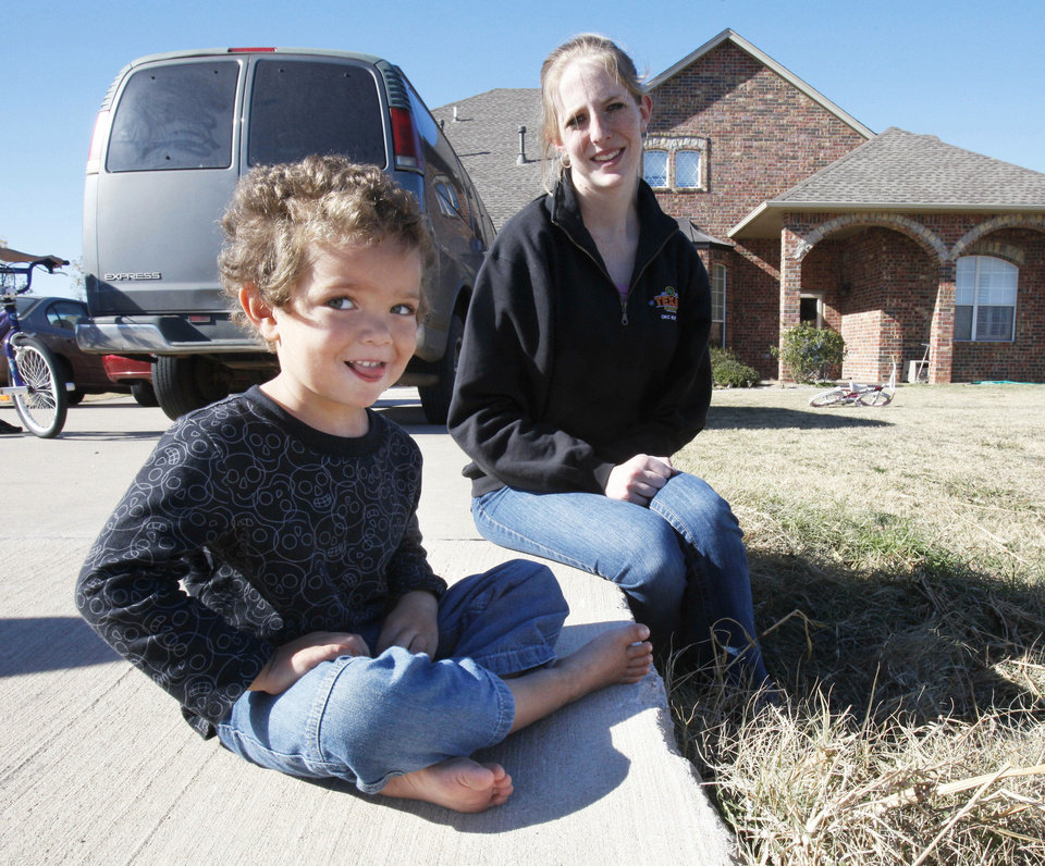 Ashley Warden was ticketed Sunday by police after her 3-year-old son, Dillan, tried to urinate in their front yard in Piedmont. Piedmont Police Chief Alex Oblein says writing the ticket was a mistake. Photo by Paul Hellstern, The Oklahoman
