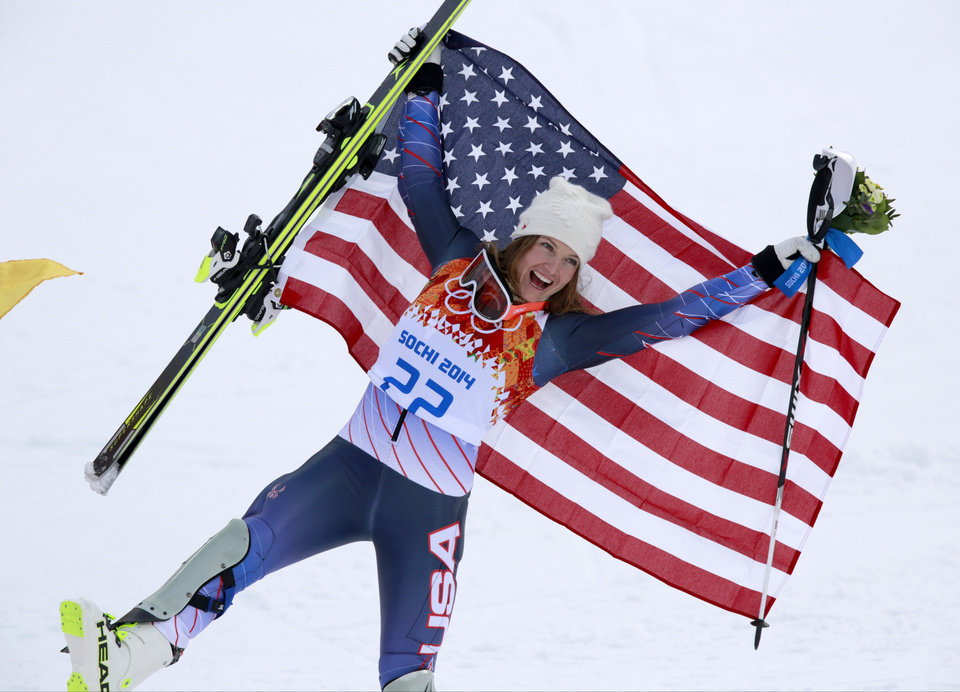 Photo - Women's supercombined bronze medalist United States' Julia Mancuso poses with the U.S. flag after a flower ceremony at the Alpine ski venue in the Sochi 2014 Winter Olympics, Monday, Feb. 10, 2014, in Krasnaya Polyana, Russia. (AP Photo/Gero Breloer)