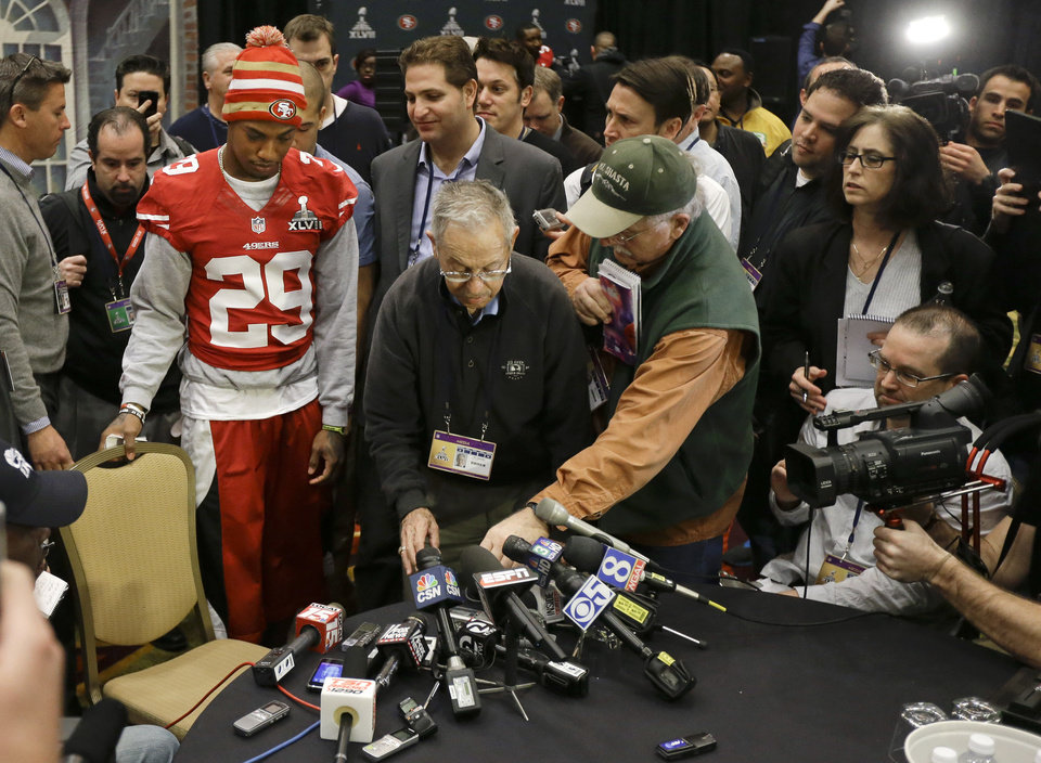 Photo - San Francisco 49ers cornerback Chris Culliver (29) takes a seat to answer questions Thursday, Jan. 31, 2013, in New Orleans, regarding anti-gay remarks he made during Super Bowl media day Tuesday. Culliver apologized for the comments he made to a comedian during an interview, saying