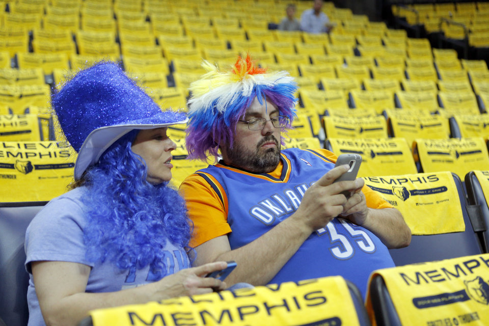 Photo - Ricky and Sandra Manning of Pauls Valley, Okla., look at pictures on their phone after meeting Kevin Durant before Game 3 in the first round of the NBA playoffs between the Oklahoma City Thunder and the Memphis Grizzlies at FedExForum in Memphis, Tenn., Thursday, April 24, 2014. Photo by Bryan Terry, The Oklahoman