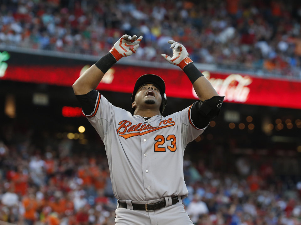 Photo - Baltimore Orioles' Nelson Cruz (23) celebrates his two-run homer during the fourth inning of an interleague baseball game against the Washington Nationals at Nationals Park, Monday, July 7, 2014, in Washington. (AP Photo/Alex Brandon)