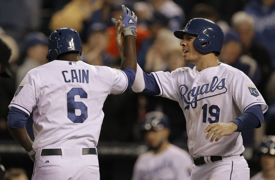 Photo - Kansas City Royals' Lorenzo Cain (6) is congratulated by teammate Danny Valencia (19) following his two-run home run off Colorado Rockies starting pitcher Franklin Morales during the fourth inning of a baseball game at Kauffman Stadium in Kansas City, Mo., Tuesday, May 13, 2014. (AP Photo/Orlin Wagner)