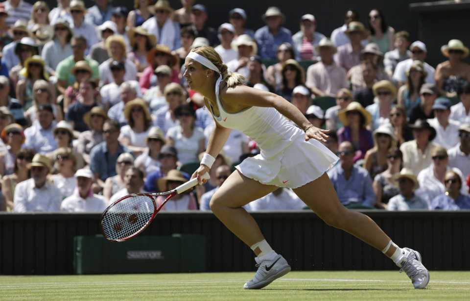 Sabine Lisicki of Germany runs for a return to Marion Bartoli of France during their Women's singles final match at the All England Lawn Tennis Championships in Wimbledon, London, Saturday, July 6, 2013. (AP Photo/Anja Niedringhaus)