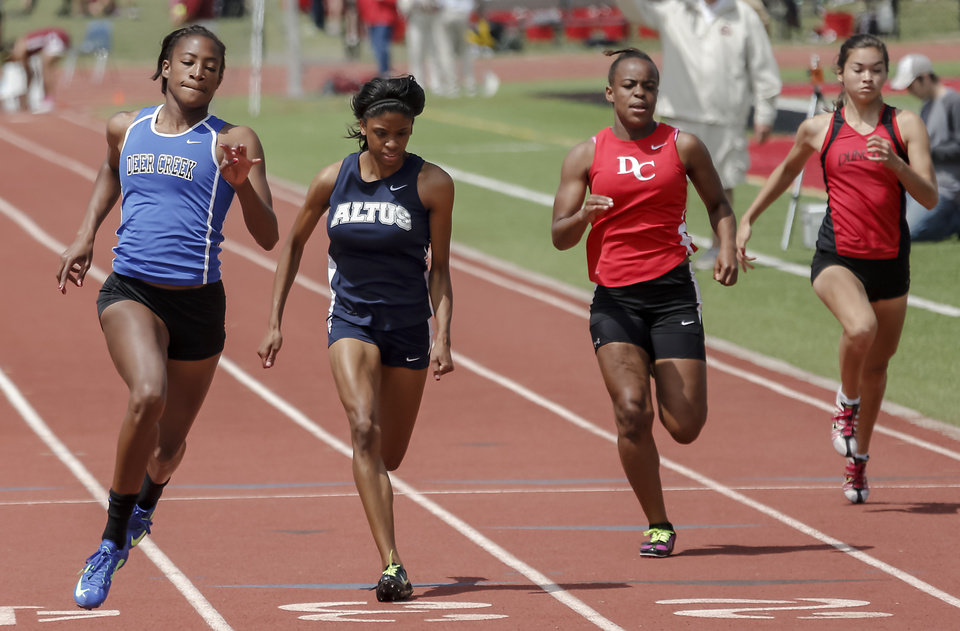 Photo - Deer Creek's Jade Orange leads the way in the 5A girls 100m dash during the class 5A and 6A track state championships at Yukon High School on on Friday, May 10, 2013, in Yukon, Okla.Photo by Chris Landsberger, The Oklahoman