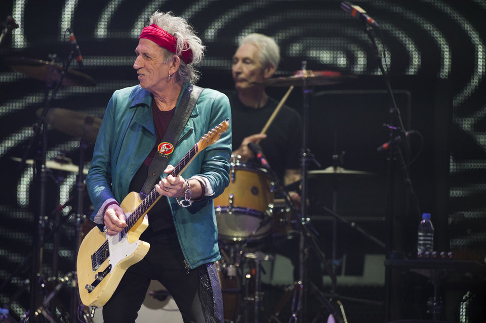 Photo - Keith Richards, left, and Charlie Watts of The Rolling Stones perform in concert on Saturday, Dec. 8, 2012 in New York. (Photo by Charles Sykes/Invision/AP)