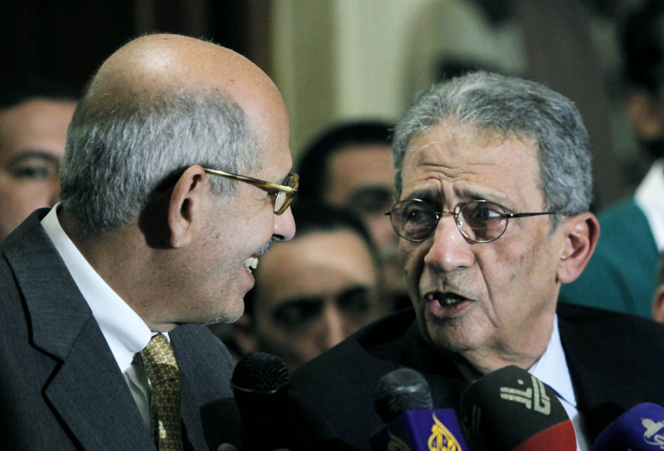 former director of the U.N.'s nuclear agency and Nobel peace laureate, Mohamed El Baradei, left, speaks with former Egyptian Foreign Minister and presidential candidate, Amr Moussa during a press conference following the meeting of the National Salvation Front in Cairo, Egypt, Monday, Jan. 28, 2013. Egypt's main opposition coalition has rejected the Islamist president's call for dialogue to resolve the country's political crisis, unless their conditions are met. (AP Photo/Amr Nabil)