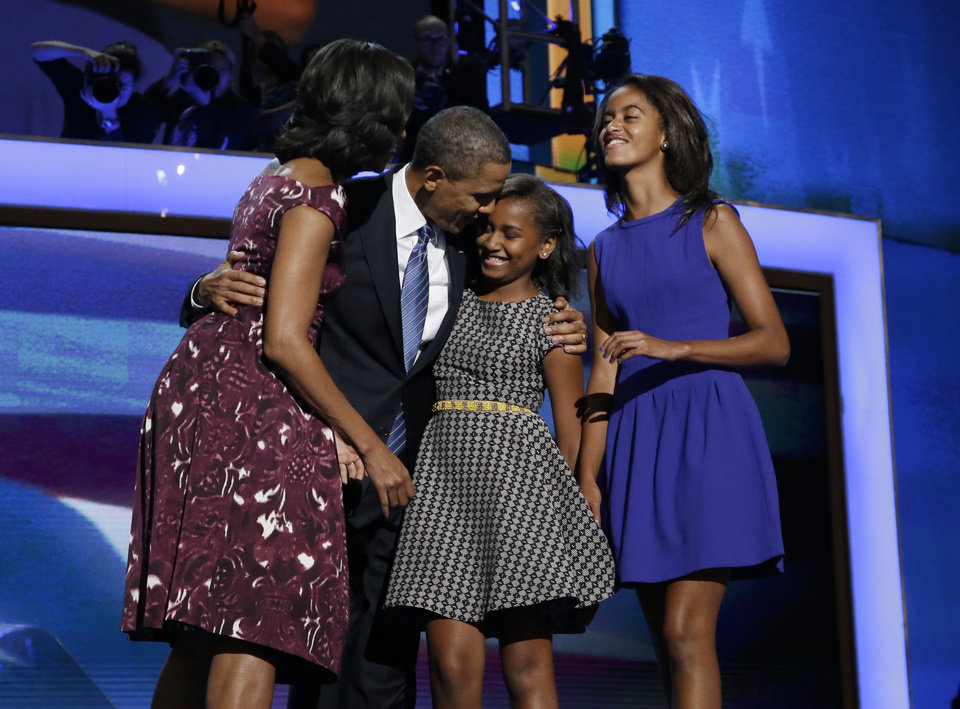 Photo -   President Barack Obama, left, is joined on stage by first lady Michelle Obama, left, their children Sasha and Malia, right, on the final day of the Democratic National Convention in Charlotte, N.C., Thursday, Sept. 6, 2012.(AP Photo/Charles Dharapak)
