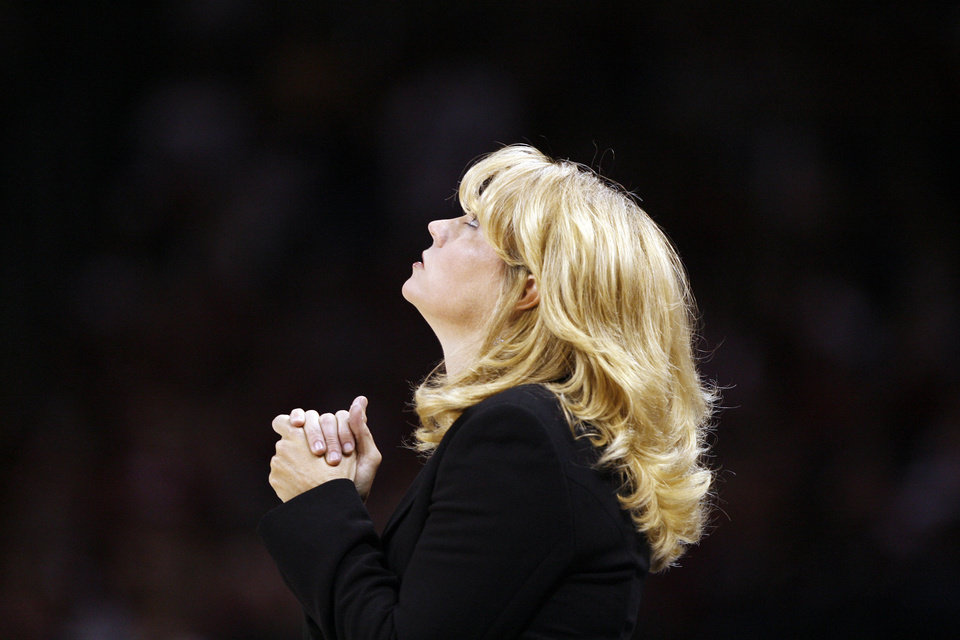 Photo - Head coach Sherri Coale looks at the scoreboard in the first half as the University of Oklahoma (OU) plays Purdue in the NCAA women's basketball regional tournament finals at the Ford Center in Oklahoma City, Okla., on Tuesday, March 31, 2009.   Photo by Steve Sisney, The Oklahoman