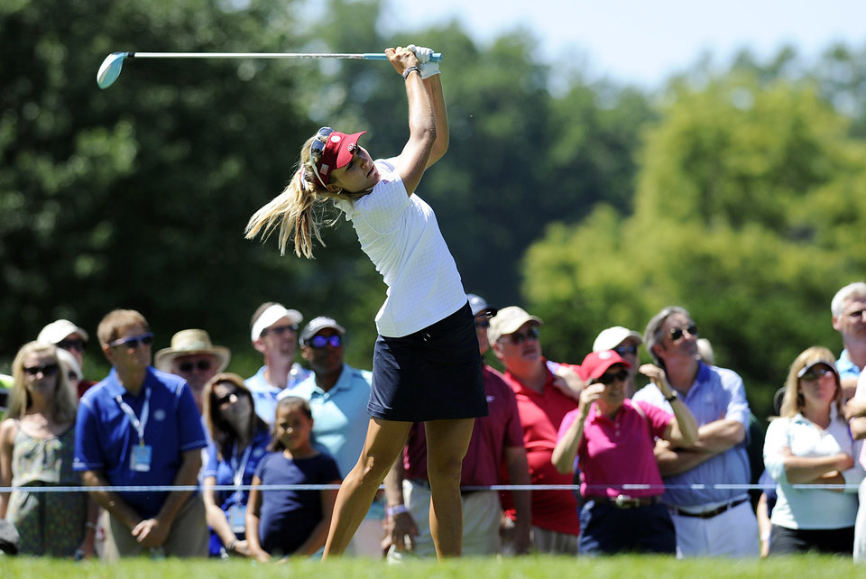 Photo - Lexi Thompson drives on the 16th hole during the second round of the International Crown golf tournament Friday, July 25, 2014, in Owings Mills, Md. (AP Photo/Gail Burton)