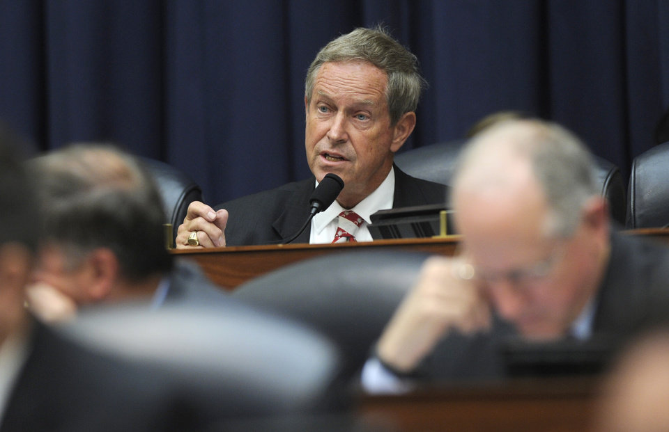 Photo - House Armed Services Committee member Rep. Joe Wilson, R-S.C., questions Defense Secretary Chuck Hagel during the committee's hearing on Capitol Hill in Washington, Wednesday, June 11, 2014. The committee is investigating the deal that secured the end of Army Sgt. Bowe Bergdahl's five-year captivity. In exchange, the U.S. transferred five high-level detainees from the U.S. prison at Guantanamo Bay, Cuba, to the Gulf emirate of Qatar.  (AP Photo/Susan Walsh)