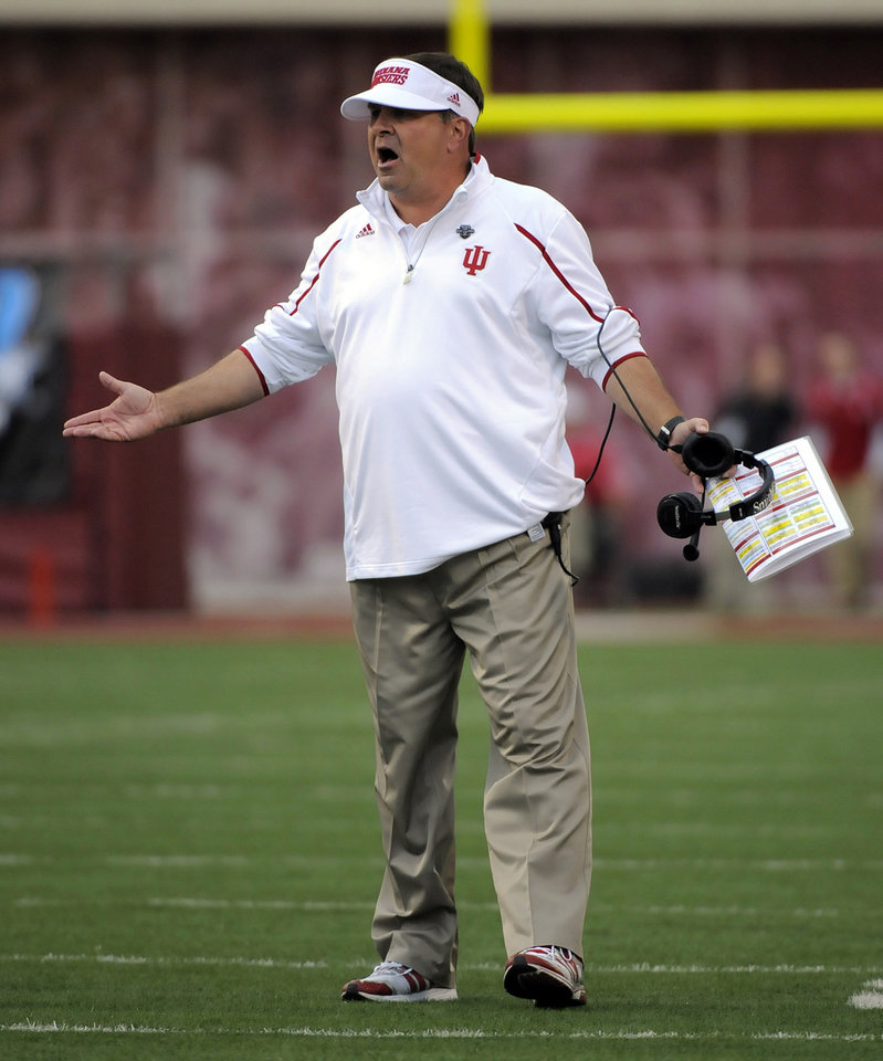 Photo - Indiana's head coach Kevin Wilson reacts to a field goal during the first half of an NCAA college football game against Minnesota in Bloomington, Ind., Saturday, Nov. 2, 2013. (AP Photo/ Alan Petersime)