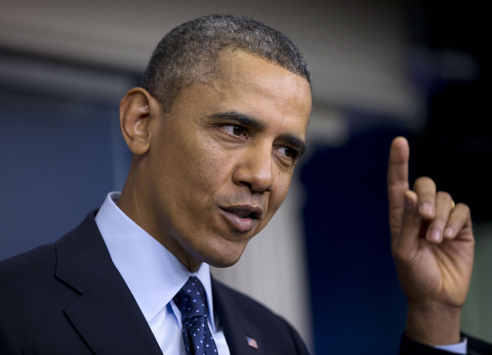 Photo - President Barack Obama gestures as he speaks to reporters in the White House briefing room in Washington, Friday, March 1, 2013, following a meeting with congressional leaders regarding the automatic spending cuts. (AP Photo/Carolyn Kaster)