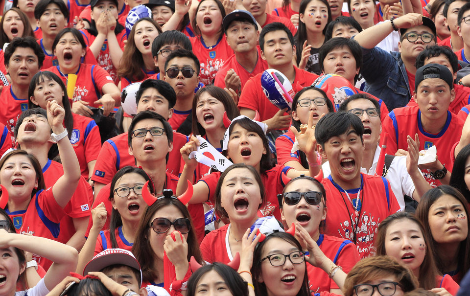 Photo - South Korean soccer fans react after Russian soccer team scored a goal against South Korea during  the group H World Cup soccer match between Russia and South Korea, at a public viewing venue in Seoul, South Korea, Wednesday, June 18, 2014. (AP Photo/Ahn Young-joon)