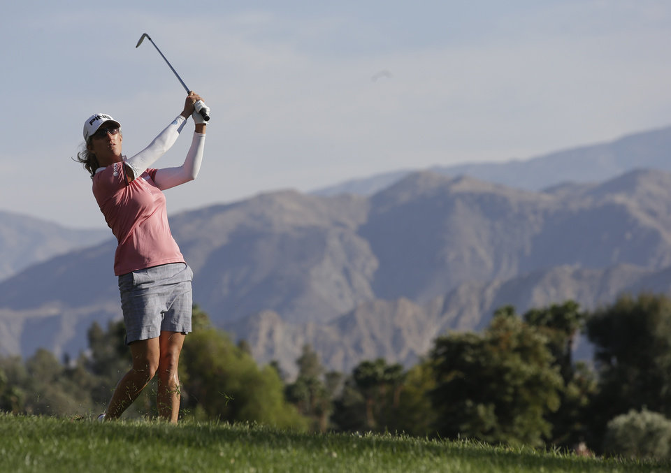 Photo - Giulla Sergas, of Italy, hits from the rough on the seventh hole during the second round of the LPGA Kraft Nabisco Championship golf tournament in Rancho Mirage, Calif. Friday, April 5, 2013. (AP Photo/Chris Carlson)
