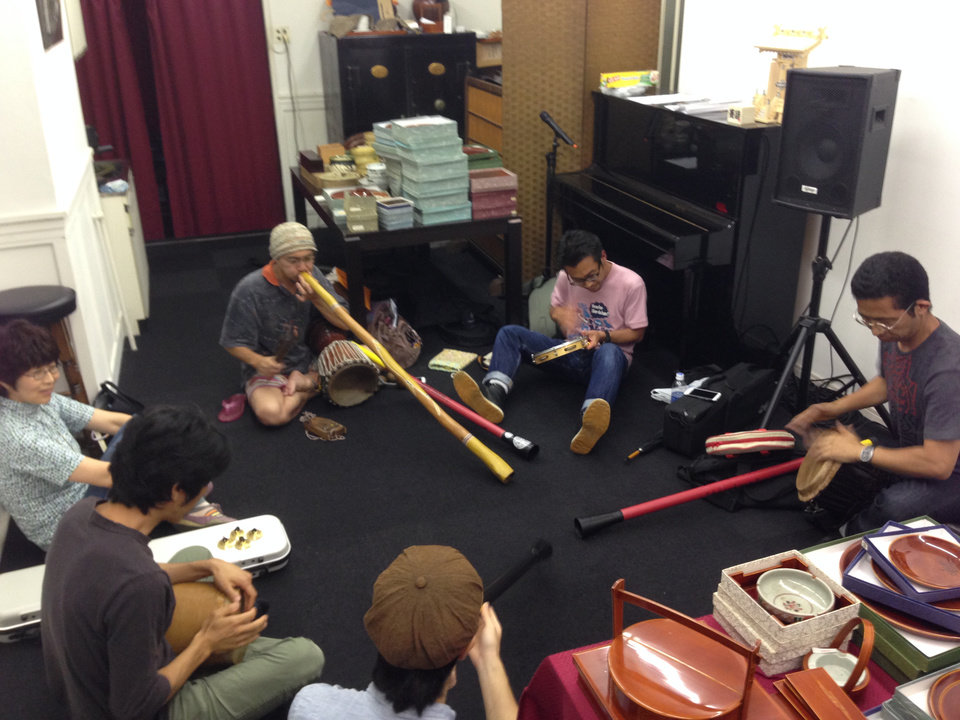 Photo -       Japanese music group playing their instruments.