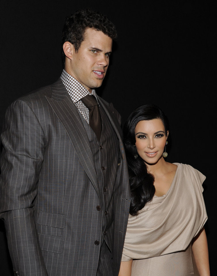 Photo - FILE - In this Aug. 31, 2011 file photo, newlyweds Kim Kardashian and Kris Humphries attend a party thrown in their honor at Capitale in New York. Attorneys for Kardashian and Humphries are due in a Los Angeles courtroom on Friday, Feb. 15, 2013 to argue over a trial date to end the couple's 72-day marriage. Humphries is seeking to delay the case until after the NBA season is over, while Kardashian wants the marriage ended as soon as possible. (AP Photo/Evan Agostini, File)