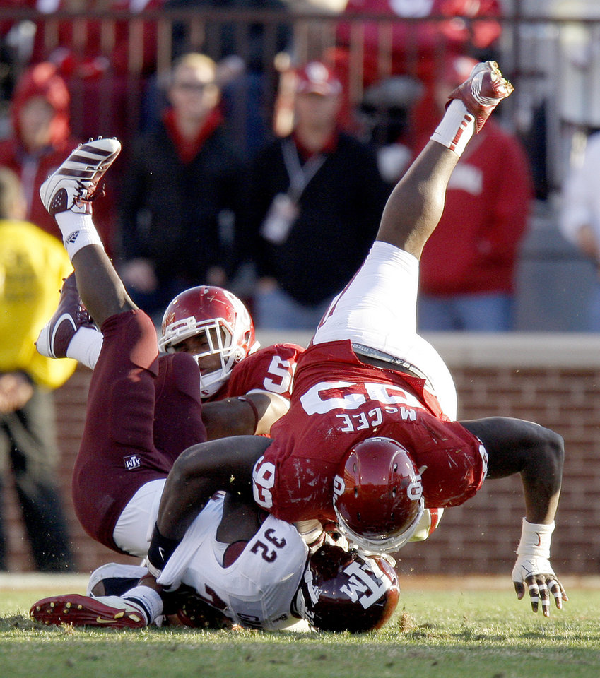Oklahoma's Stacy McGee (92) brings down Texas A&M's Cyrus Gray (32) during the college football game between the Texas A&M Aggies and the University of Oklahoma Sooners (OU) at Gaylord Family-Oklahoma Memorial Stadium on Saturday, Nov. 5, 2011, in Norman, Okla. Oklahoma won 41-25. Photo by Bryan Terry, The Oklahoman