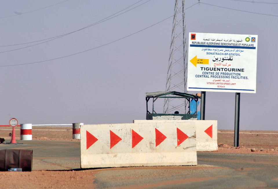 Photo - Roadblocks prevent the access of the Tigentourine gas plant where hostages have been kidnapped by islamic militants, Friday, Jan. 18, 2013. The hostage crisis in the remote desert of Algeria is not over, Britain said Friday, after an Algerian raid on the gas plant to wipe out Islamist militants and free their captives from at least 10 countries unleashed bloody chaos. (AP Photo/Anis Belghoul)