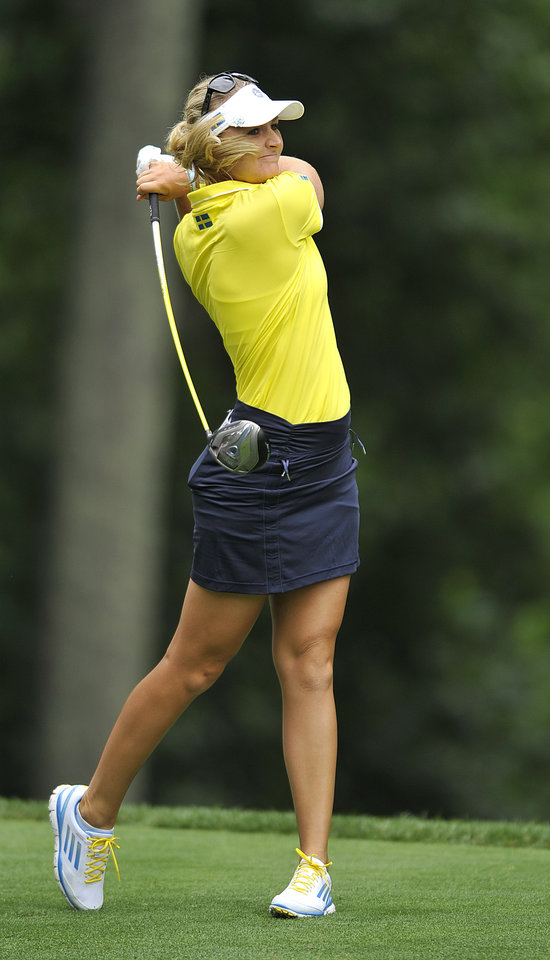 Photo - Anna Nordquist, of Sweden, tees of the seventh hole during the first round of the International Crown LPGA golf tournament Thursday, July 24, 2014, in Baltimore.(AP Photo/Gail Burton)