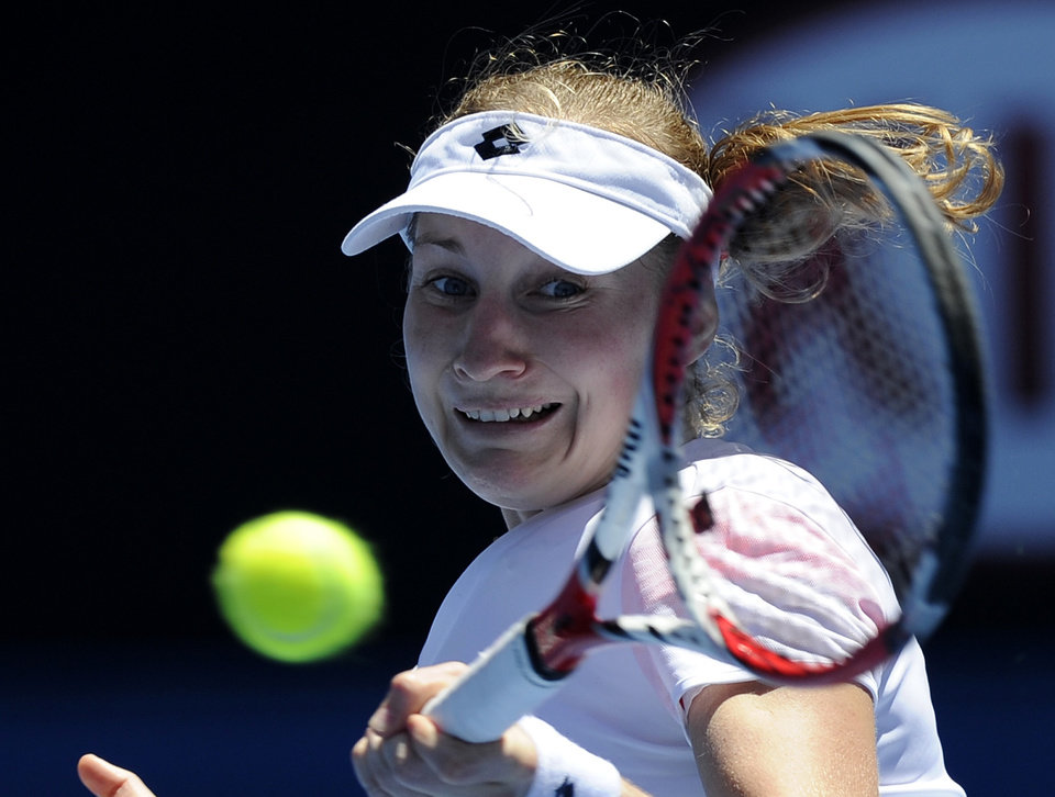 Photo - Ekaterina Makarova of Russia makes a forehand return during her first round match against Venus Williams of the U.S. at the Australian Open tennis championship in Melbourne, Australia, Monday, Jan. 13, 2014. (AP Photo/Andrew Brownbill)