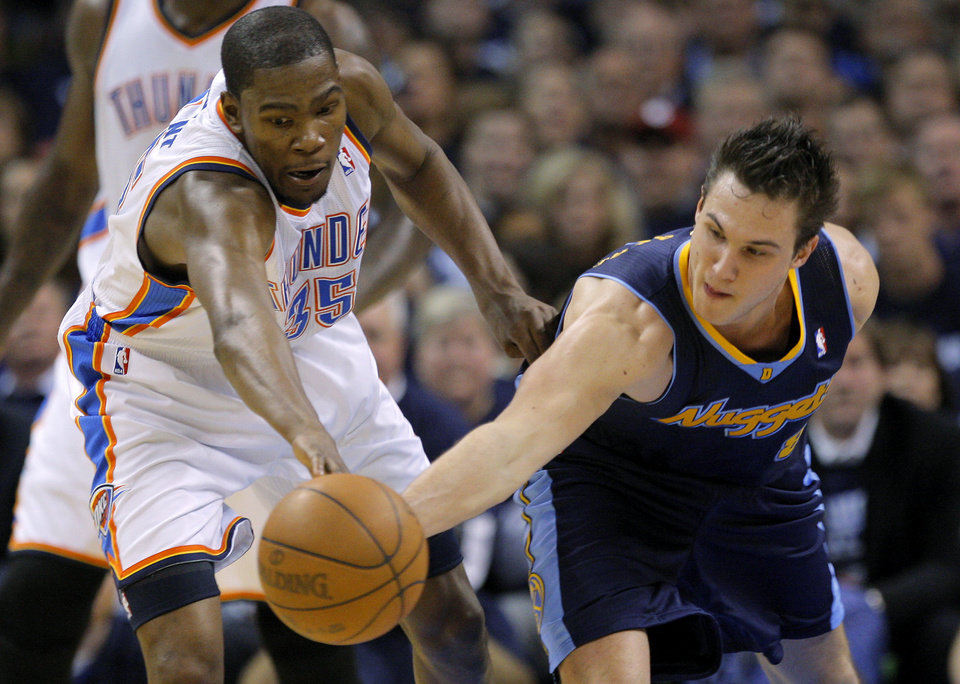 Photo - Oklahoma City's Kevin Durant (35) goes for the ball beside Denver's Danilo Gallinari (8) during the NBA basketball game between the Denver Nuggets and the Oklahoma City Thunder in the first round of the NBA playoffs at the Oklahoma City Arena, Wednesday, April 27, 2011. Photo by Bryan Terry, The Oklahoman