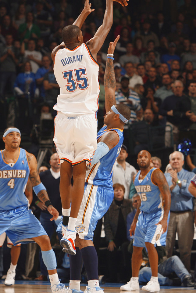 Kevin Durant scores a three point basket with two seconds left to put the Thunder ahead and in the second half as the Oklahoma City Thunder play the Denver Nuggets at the Ford Center in Oklahoma City, Okla. on Friday, January 2, 2009.  Photo by Steve Sisney/The Oklahoman