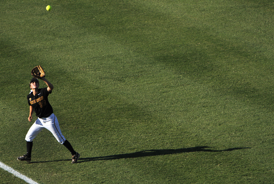 Arizona's Talor Haro (22) catches a ball in the outfield during a Women's College World Series game between Arizona State and LSU at ASA Hall of Fame Stadium in Oklahoma City, Saturday, June 2, 2012. Photo by Garett Fisbeck, The Oklahoman