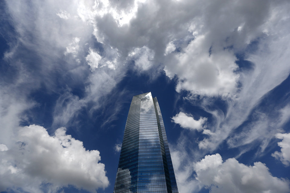Photo - Clouds swirl around the Devon Tower, Thursday July 18, 2013, in Oklahoma City. Photo by Sarah Phipps, The Oklahoman
