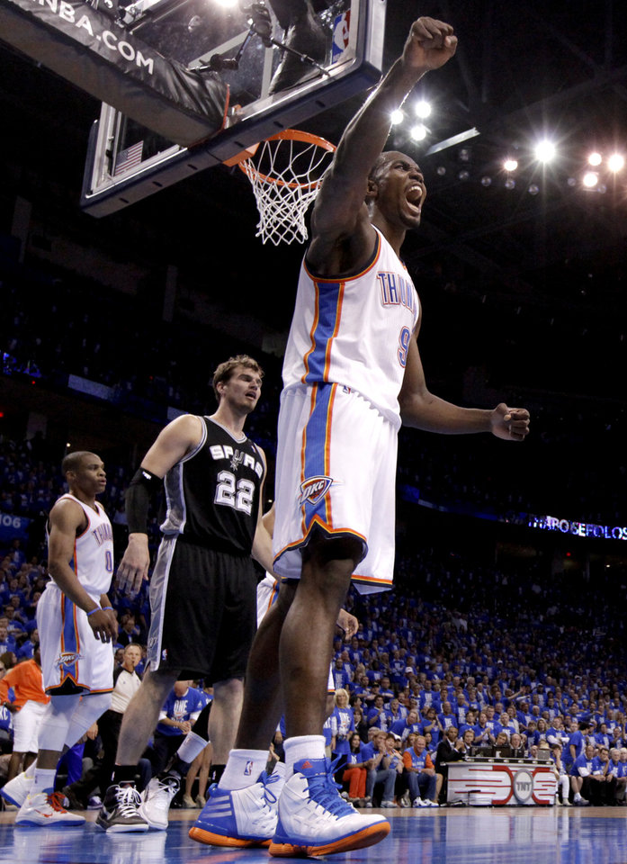Photo - Oklahoma City's Serge Ibaka (9) celebrates a offensive foul in front of San Antonio's Tiago Splitter (22) during Game 3 of the Western Conference Finals between the Oklahoma City Thunder and the San Antonio Spurs in the NBA playoffs at the Chesapeake Energy Arena in Oklahoma City, Thursday, May 31, 2012.  Photo by Sarah Phipps, The Oklahoman