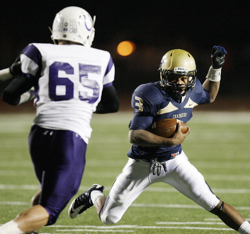 Photo - Sterling Shepard (3) of Heritage Hall tries to get past Darren Davenport (65) of Bethany during the Class 3A high school football semifinal playoff  game between Heritage Hall and Bethany at Putnam City High School in Oklahoma City, Saturday, December 4, 2010. Photo by Nate Billings, The Oklahoman