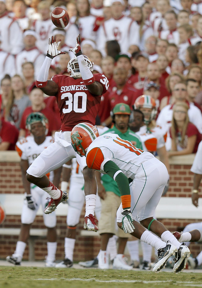 Oklahoma's Javon Harris (30) intercepts a pass intended for Florida A&M's Anthony Williams (11) during the college football game between the University of Oklahoma Sooners (OU) and Florida A&M Rattlers at Gaylord Family—Oklahoma Memorial Stadium in Norman, Okla., Saturday, Sept. 8, 2012. Photo by Bryan Terry, The Oklahoman