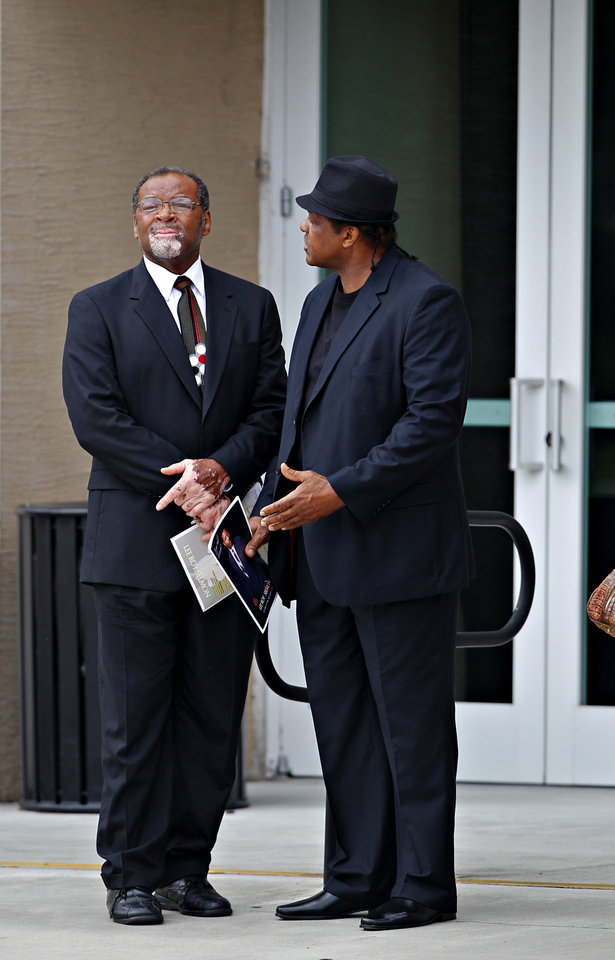 Photo - Dewey Selmon, left, stands outside of a memorial service held for his brother and former Tampa Bay Buccaneers football player and Hall of Famer Lee Roy Selmon at Idlewild Baptist Church in Lutz, Fla. on Friday, Sept. 9, 2011. (AP Photo/St. Petersburg Times, Daniel Wallace)  TAMPA OUT; CITRUS COUNTY OUT; PORT CHARLOTTE OUT; BROOKSVILLE HERNANDO TODAY OUT  ORG XMIT: FLPET201
