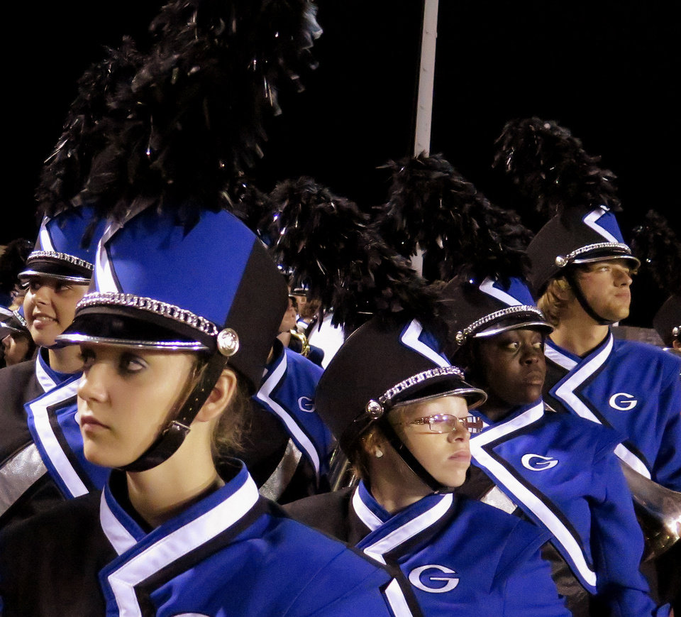 Photo - Guthrie band trumpeter Kristen Benham, a junior, waits for the half to end so they can take the field during the high school football game between Guthrie at Carl Albert in Midwest City, Friday, October 11, 2013.  Photo by Doug Hoke, The Oklahoman