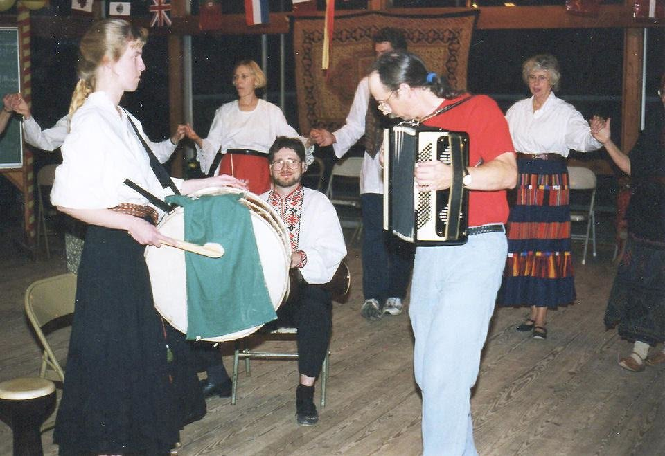 Photo - Ann Alexander plays a drum and Don Weeda plays an accordion at a past Old Country Weekend event of the Oklahoma City International Folkdancers.  Photo provided
