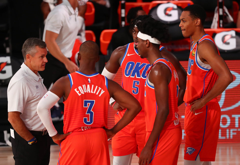 Photo - August 7, 2020; Lake Buena Vista, Florida, USA; Oklahoma City Thunder head coach Billy Donovan speaks with his players during a time out against the Memphis Grizzlies in the first half of an NBA game at Visa Athletic Center. Mandatory Credit: Kim Klement-USA TODAY Sports