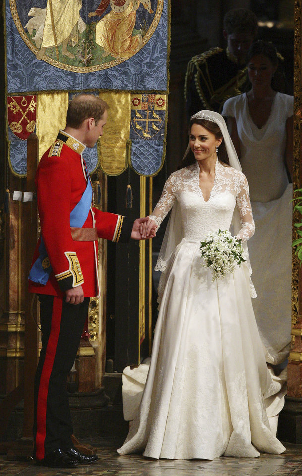 Photo - Britain's Prince William, left, and his wife Kate, the Duchess of Cambridge, prepare to leave Westminster Abbey following their marriage, London, Friday, April 29, 2011. (AP Photo/Dave Thompson, Pool) ORG XMIT: RWDA109