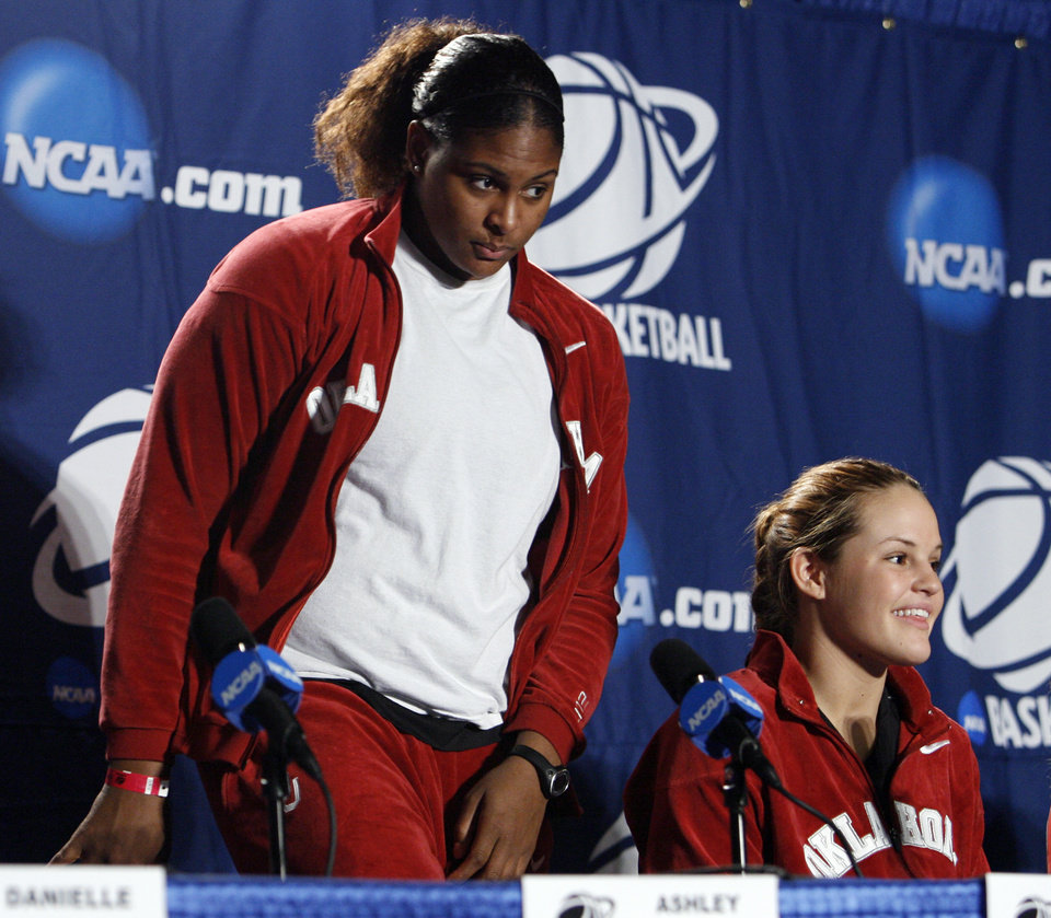 Photo - University of Oklahoma players Courtney Paris and Whitney Hand prepare to speak to the media before the Sooners elite eight appearance in NCAA women's basketball tournament at the Ford Center in Oklahoma City, Okla. on Monday, March 30, 2009. 