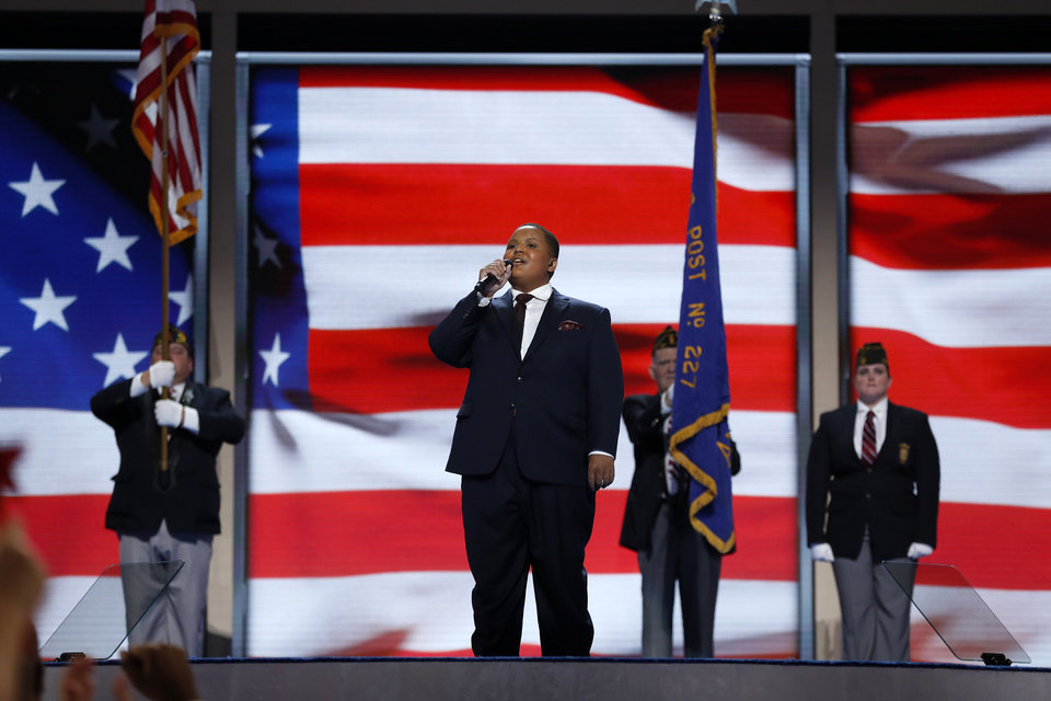 Photo - Bobby Hill form the Keystone State Boyschoir sings the National Anthem during the first day of the Democratic National Convention in Philadelphia , Monday, July 25, 2016. (AP Photo/Carolyn Kaster)