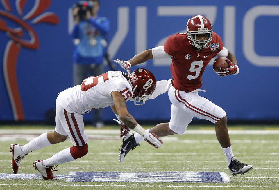 Alabama's Amari Cooper (9) runs past Oklahoma's Zack Sanchez (15) during the NCAA football BCS Sugar Bowl game between the University of Oklahoma Sooners (OU) and the University of Alabama Crimson Tide (UA) at the Superdome in New Orleans, La., Thursday, Jan. 2, 2014.  .Photo by Chris Landsberger, The Oklahoman