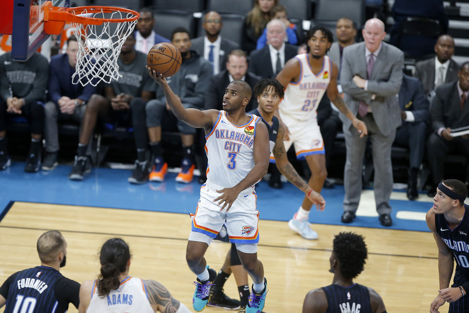 Photo - Oklahoma City's Chris Paul (3) goes to the basket during an NBA basketball game between the Oklahoma City Thunder and the Orlando Magic at Chesapeake Energy Arena in Oklahoma City, Tuesday, Nov. 5, 2019. Oklahoma City won 102-94. [Bryan Terry/The Oklahoman]